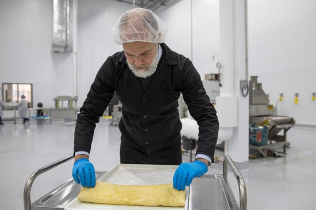 Nature's Fynd's CEO Thomas Jonas works with a sheet of Fy, a protein made from fermented microbial fungi, in the company's Chicago facility. Photo courtesy of Nature's Fynd