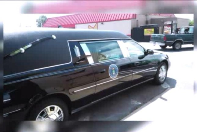 David Disch snapped this photo Saturday of a hearse containing a flag-draped coffin parked unattended at a Virginia Beach Hardee's. WTKR-TV screenshot