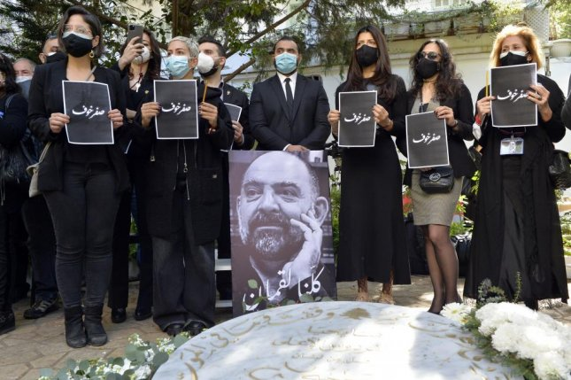 Activists pay tribute to Lokman Slim at Dahyieh south of Beirut, Lebanon, on February 11, a week after he was found shot to death in a rental car in Nabatiyeh, southern Lebanon. File photo by Wael Hamzeh/EPA-EFT