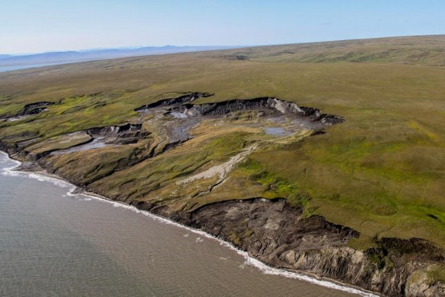 Scientists consider the effects of coastal erosion in the arctic an eroding cliff line along the coast of canadas herschel island photo by alfred wegener institute thecheapjerseys Image collections