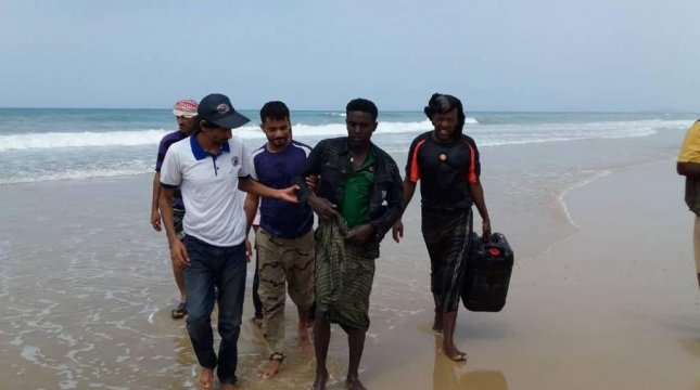 International Organization for Migration staff assist a man who survived a drowning near the coast of Yemen. At least 46 people died. Photo courtesy of IOM