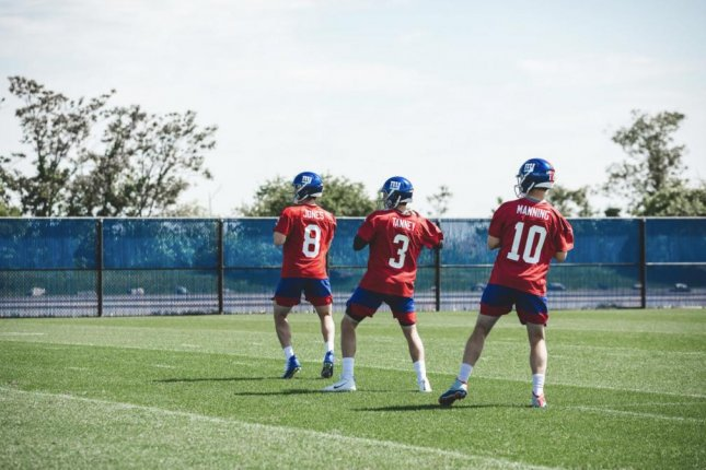 New York Giants veteran Eli Manning (R) is expected to start the season as the team's starting quarterback. Rookie Daniel Jones (L) was picked in the first round of the 2019 NFL Draft to serve as Manning's eventual replacement. Photo courtesy of the New York Giants