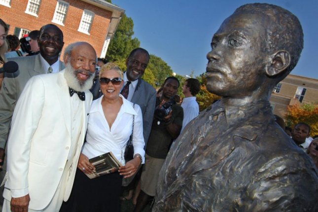 James Meredith (in bow tie) and his wife (right) see his likeness in the form of a bronze statue for the first time Oct. 1 at the dedication of the civil rights monument at the University of Mississippi. (University of Mississippi/Robert Jordan)