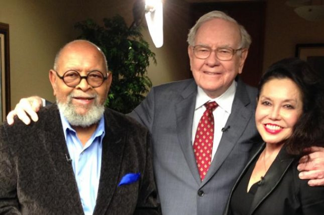 Berkshire Hathaway CEO Warren Buffett, center, poses for a photo with Glide founders the Rev. Cecil Williams and Janice Mirikitani. A charity auction to have lunch with Buffett raised $3,456,789 for Glide, which helps homeless people in the San Francisco Bay Area get back on their feet. Photo courtesy Glide