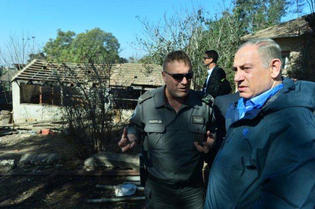 Israeli Prime Minister Benjamin Netanyahu toured the site of the fire at Beit Meir, near Jerusalem, on Friday and met with firefighters taking control of several fires that broke out across Israel this week. He later toured the devastation in Haifa. Photo courtesy Office of the Prime Minister/Twitter