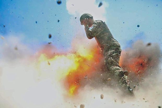 A mortar tube accidentally explodes on July 2, 2013, during a live-fire training exercise with the Afghan National Army. The accident killed four ANA soldiers, as well as U.S. Army Spc. Hilda Clayton, an Army photographer who took this photo. Photo by Spc. Hilda Clayton/U.S. Army