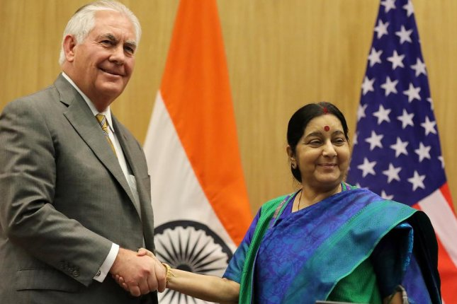 U.S. Secretary of State Rex Tillerson (L) and Indian Foreign Minister Sushma Swaraj (R) shake hands after a joint press statement in New Delhi, India, on Wednesday. Photo by Harish Tyagi/EPA-EFE