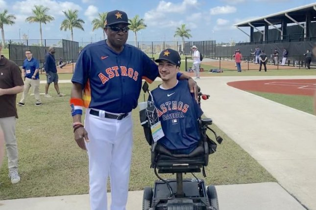 Houston Astros manager Dusty Baker signed an autograph for Jimmy V Award winner Rob Mendez at spring training Wednesday in West Palm Beach, Fla. Photo by Alex Butler/UPI