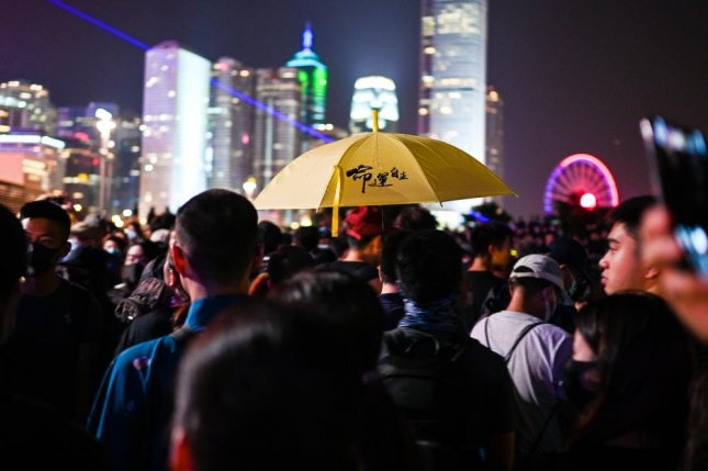 A protester carries an umbrella at a rally commemorating the fifth anniversary of the Umbrella Movement, Hong Kong's 2014 pro-democracy movement, in Tamar Park on Saturday. Photo by Thomas Maresca/UPI