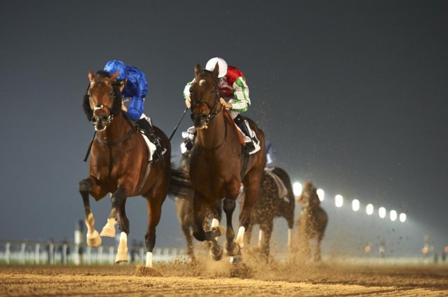 Caption: Thunder Snow (blue) gets by North America to win Thursday night's Group 2 Al Maktoum Challenge Round 2 at Meydan and further his cause as a Dubai World Cup contender. (DRC/Andrew Watkins)
