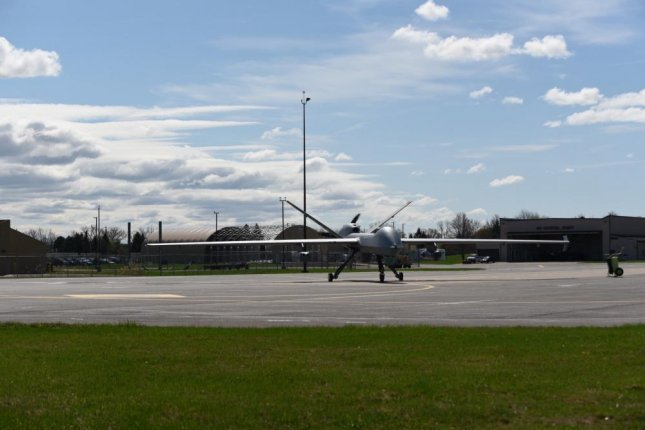An MQ-9 Reaper with three Ghost Reaper pods attached awaits takeoff at Hancock Field Air National Guard Base, Syracuse, N.Y. Photo by Megan Fowler/U.S. Air National Guard