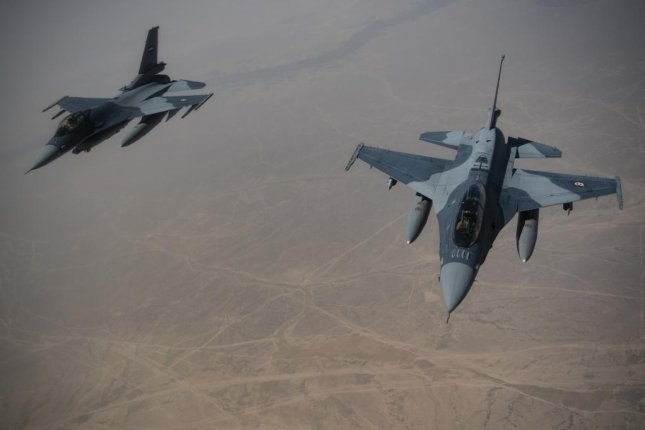 Iraqi air force F-16 Fghting Falcons conduct a training mission over Iraq on May 26, 2019. Photo by Master Sgt. Russ Scalf/U.S. Air Force