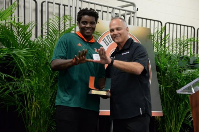 Miami Hurricanes tight end Michael Irvin II (L) is expected to be sidelined up to four months with a knee injury, the school announced Wednesday. Photo courtesy of Miami Hurricanes Football/Twitter