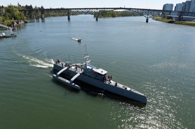 The highly autonomous unmanned ship Sea Hunter gets underway following a christening ceremony in Portland, Ore., Thursday. Photo courtesy U.S. Navy