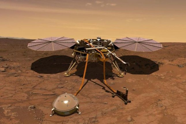 An illustration shows NASA's InSight lander with its solar arrays spread and its two main instruments, its domed seismometer and 16-foot heat probe, deployed. Photo courtesy of NASA/JPL-Caltech
