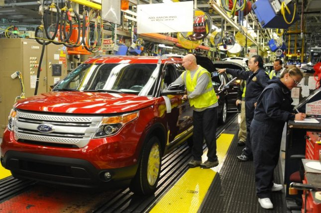 Ford employees work on a Ford Motor Co. assembly line in Chicago, Ill. File Photo by Tannen Maury/EPA-EFE