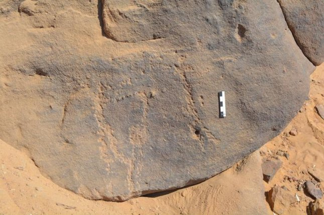 The 6000-year-old rock engravings, a series of dots pecked into the rock with a sharp point, can barely be made out today. Photo by David Sabel/University of Bonn