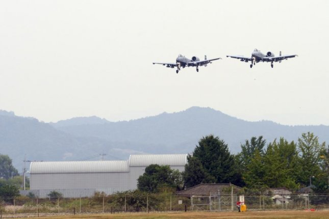 Two A-10 Thunderbolt II aircraft from the 25th Fighter Squadron land at Osan Air Base, Republic of Korea, in 2015. Photo by Robert Howard/U.S. Air Force