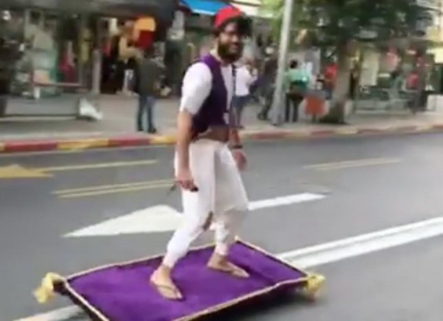 A man was seen riding a mechanical magic carpet down the streets of Israel while dressed as Aladdin. Aviad Rosenfeld shared video of the man on the first day of the Jewish celebration of Purim. The annual celebration often includes dressing in costumes and handing out food and gifts to friends and family. Screen capture/Aviad Rosenfeld/Facebook