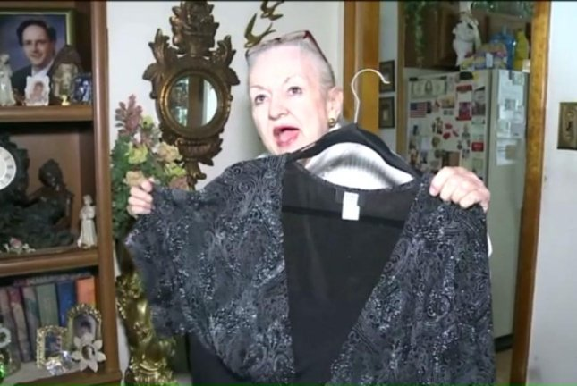 Mary Clancey shows off a dress she can no longer wear after having her 140-pound cyst removed. Screenshot: WNEP-TV