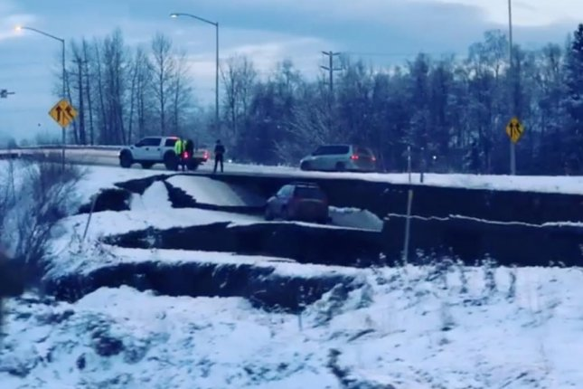 A road is left with a massive crack after a 7.2 magnitude earthquake in Anchorage, Alaska. Photo courtesy of divophoto/Instagram