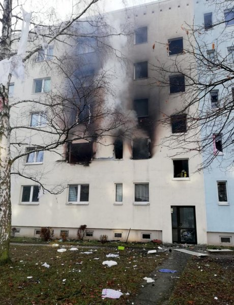 Smoke rises from the windows of an apartment building in Blankenburg, Germany, on Friday after an explosion killed a man living inside. Photo by Magdeburg Police/Twitter