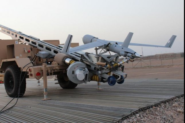 Insitu will provide a ScanEagle drone on one U.S. Coast Guard national security cutter under a contract announced by the company Monday. Pictured, a ScanEagle drone is readied for launch earlier this year in Afghanistan. U.S. military photo by Lt. Charity Edgar