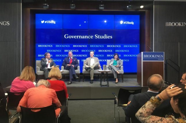 From left, Congressman David Cicilline, D-R.I., Taco, Inc. CEO John Hazen White, Jr., Brookings Institution Senior Fellow Mark Muro and moderator and Vox reporter Alexia Fernández Campbell discuss the manufacturing sector under President Donald Trump in the second panel discussion of the conference. Photo by Katherine Lee, Medill News Service