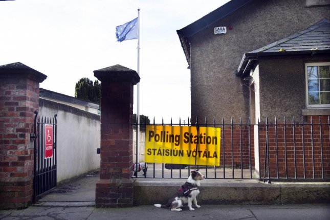 A dog waits for its owner outside a polling station during general elections in Dublin, Ireland Saturday. Photo by Aidan Crawley/EPA-EFE