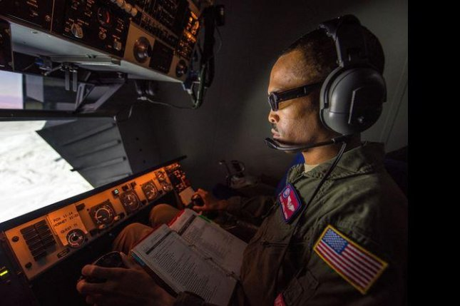 A U.S. Air Force member tests a KC-10 training system. Pinnacle Solutions Inc. received an extension to a contract for a fourth year of services this week. Photo by Louis Bricese/U.S. Air Force