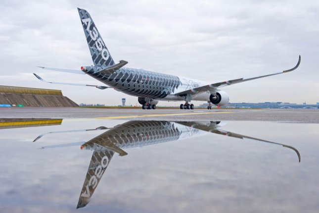 """The third A350 XWB flight-test aircraft, which features a distinctive """"Carbon"""" signature livery, will be the first A350 to transport passengers when it undertakes the Early Long Flights (ELF) later in 2014. (Credit:Airbus)"""