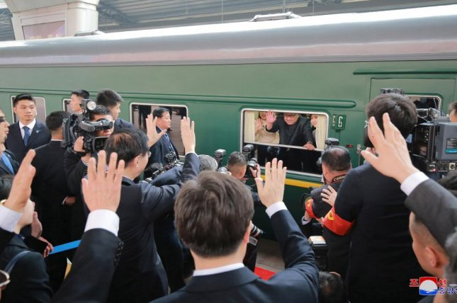 An undated photo released in March 2018 by the North Korean Central News Agency, the state news agency of North Korea, shows North Korean leader Kim Jong Un (C) waving from a train during his visit to China. File Photo by KCNA/EPA-EFE