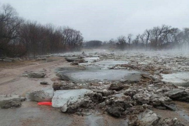 River ice litters a road near Elba, Neb., Thursday after an ice jam broke and caused flooding. Photo courtesy Nebraska National Guard