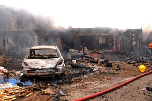 Aftermath of a bomb attack in 2014 in Jos, Nigeria by the militant group Boko Haram. Analysts have linked Boko Haram's rise to climatic shifts and resource shortages. Photo courtesy of Diariocritico de Venezuela/Flickr