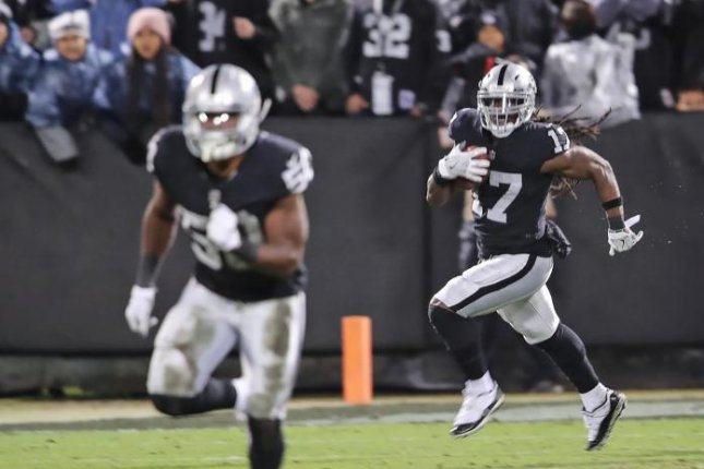 Oakland Raiders wide receiver Dwayne Harris returns a punt for a 99-yard touchdown against the Denver Broncos on Monday in Oakland. Photo courtesy of the Oakland Raiders/Tony Gonzales