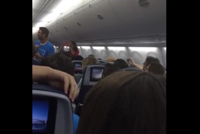 A Tennessee choir performs aboard a plane bound for the British Virgin Islands. Screenshot: Lee University Campus Choir/Facebook