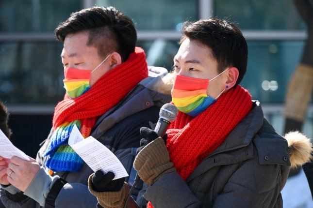 Same-sex couple Kim Yong-min and So Seong-wook filed a lawsuit against South Korea's national health insurance agency on Wednesday seeking the right to register So as a dependent. Photo by Thomas Maresca/UPI