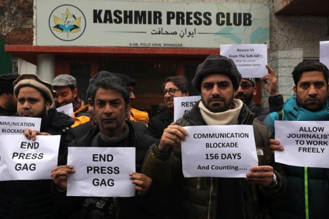 Kashmiri journalists hold placards during a protest against the ongoing Internet blockade Monday. India's Supreme Court ordered the government Friday to review the measure. Photo by Farooq Khan/EPA-EFE