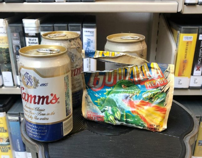 Workers at the Walla Walla Public Library in Washington state were dismantling a shelf in the mystery section when they found a stash of beer and chewing gum believed to date from the 1980s. Photo courtesy of the City of Walla Walla