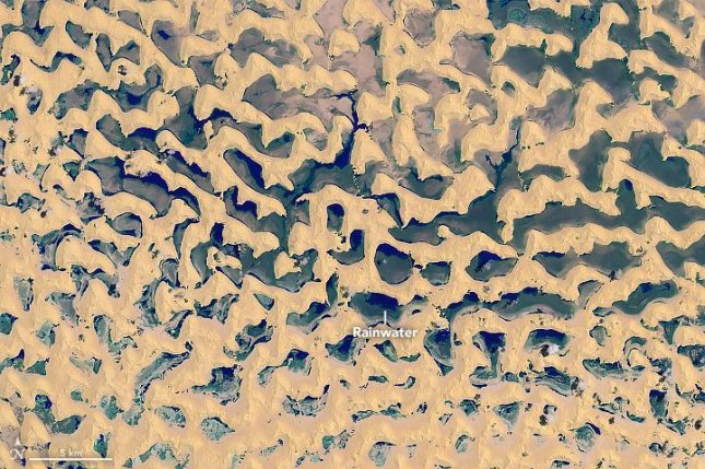 A tropical cyclone produced dozens of small lakes in the flats of the Rub' al-Khali, the world's largest contiguous sand desert. Photo by NASA/Landsat 8/OLI