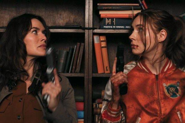 Lena Headey (L) and Karen Gillan play mother-daughter assassins in Gunpowder Milkshake, a new action thriller coming to Netflix in July. Photo courtesy of Netflix