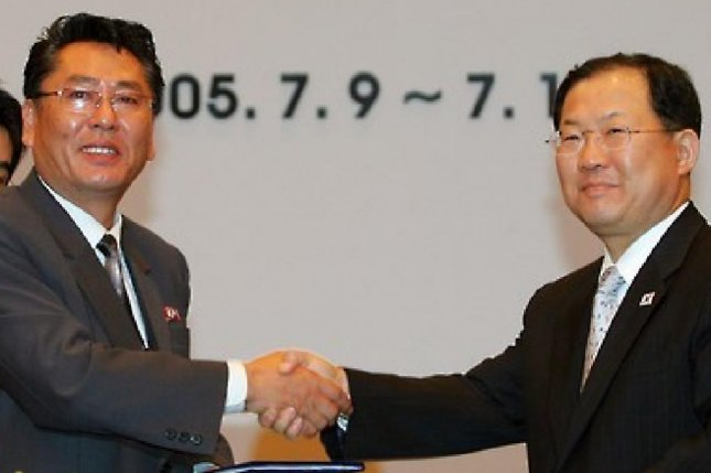 Choe Yong Gon (L), vice premier of North Korea, was active in inter-Korea relations. In 2005, he met with his South Korea counterpart Park Byeong-won in Seoul to exchange a 12-point trade document. File photo by Yonhap