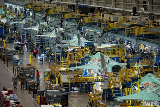 F-35 fighter planes are on the Lockheed Martin assembly line in Fort Worth, Texas. A Government Accountability Office report said on Monday that the Pentagon is not considering contractors' risks involving climate change. Photo courtesy of Lockheed Martin