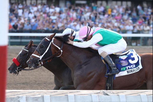 Mandaloun (inside) won Saturday's Grade I Haskell after Hot Rod Charlie was disqualified for interference. Photo courtesy of Monmouth Park