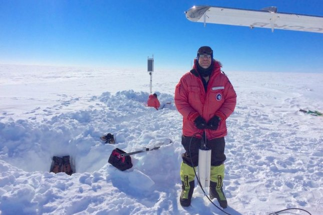 Researcher Rick Aster inserts a broadband seismometer into the snow atop Antarctica's Ross Ice Shelf