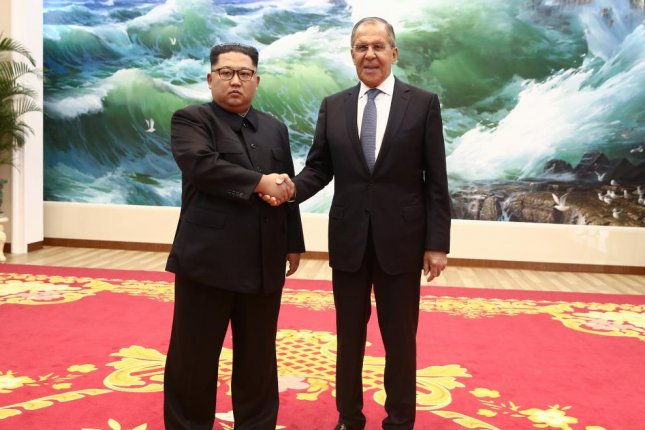 Russian Foreign Minister Sergei Lavrov shakes hands with Kim Jong Un in Pyongyang, North Korea, on Thursday. Photo courtesy of Russian Foreign Ministry/EPA-EFE