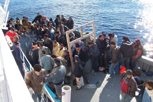 Migrants arrive at the port of Lampedusa, Italy. The European Union is preparing a proposal to distribute migrants to Europe, typically arriving to escape tyranny and hunger, to each nation in the bloc. File Photo by wikimedia.org/ V. Manzari.
