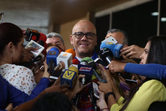 Jorge Rodríguez, head of a signature-verification commission established by the Venezuelan government during the opposition's presidential recall efforts, annonced he'd petitioned the National Electoral Council, or CNE, to nullify the Democratic Unity Roundtable opposition coalition's registration as a political party. He made the announcement to the press outside of CNE headquarters. Photo courtesy of Jorge Rodríguez