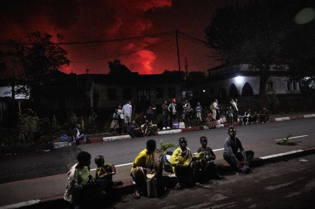 Congolese residents of Goma gather at Rond Point Cercle to flee from erupting Mount Nyamulagira and Mount Nyiragongo part of the Virunga National Park in Goma, Democratic Republic of the Congo Saturday. Photo by Kinsella Cunningham/EPA-EFE