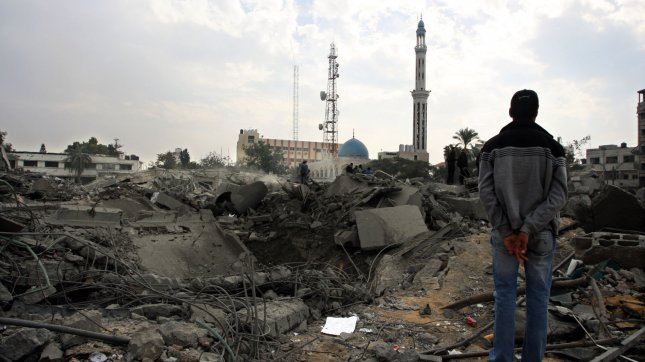 A Palestinian looks at the destroyed Al-Saraya headquarters in Gaza City November 22, 2012, a day after a cease fire was declared between Israel and the Islamic Palestinian movement. The Egypt-brokered truce took hold in the Gaza Strip after a week of bitter fighting between militant groups and Israel, with both sides claiming victory but remaining wary. UPI/Ismael Mohamad